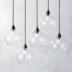 """Shop firefly pendant light.   Industrial modern chandelier suspends five glass globes from black iron canopy.  Pendants stagger in length on black cords 15"""" to 29"""".  Great look with filament bulbs.  Hanging hardware included.  Learn about  on our blog."""