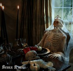 Haunted Halloween Dining Room - love the cheesecloth and tiara draped skeleton (bridal like and hides the inexpensive skeleton some)