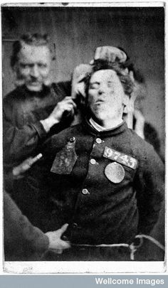 » These Photographic Portraits Of Victorian Mental Institution Patients Will Give You Chills [Photos]/Circa 1869. This patient, a young man, had to be restrained by two workers in the ward in order to get his patient identification photo for the asylum taken.
