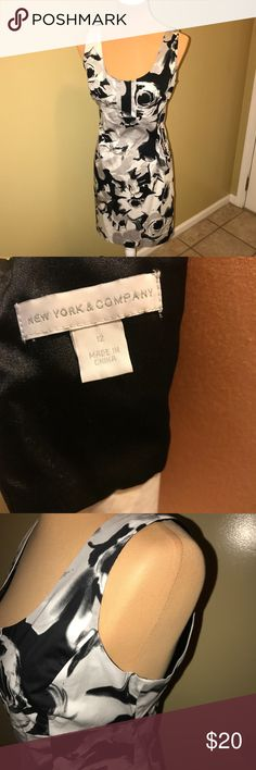 New York & Company floral dress New York & Company floral dress. All black and white beautiful floral dress. Back zip and hook. Pre-loved but well taken care of. Never been dried. Smoke free, pet free home. New York & Company Dresses
