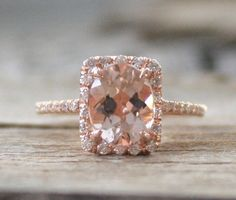 Beautiful 14K rose gold diamond halo engagement ring featuring a natural and untreated 7 x 9 mm cushion cut Cor-de-Rosa morganite, weighing 2.0 cts