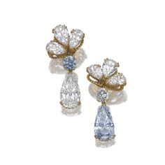 Each surmount designed as a cluster of three pear-shaped diamonds weighing 0.93, 1.07, 1.10, 1.10, 1.26 and 1.48 carats, suspending a brilliant-cut stone weighing 0.86 carat and a similarly cut fancy blue diamond weighing 0.85 carat, respectively suspending a fancy blue pear-shaped diamond weighing 5.01 carats and a similarly shaped stone weighing 5.61 carats, mounted in yellow gold by Alexandre Reza