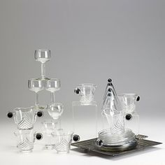 ART DECO GLASSWARE; Twenty-six pieces include Heisey glass with Bakelite disc in handles, four coffee glasses with saucers, creamer and suga...