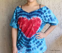 [caption id=attachment_14792 align=alignnone width=620] Tie-dye heart shirt by CraftyChica.com.[/caption]  'Tis the season for red, white, and blue. If you're looking to have some patriotic fun with your crafts in time for the fireworks, here is a cool folding technique using tie-dye, chalk, and rubber bands. How to make a Tie-Dye Heart Shirt:  Supplies:  100% cotton T-shirt, pre-washed, damp  Fabric dye in red, light blue, and dark blue (you can find this at the craft store, I like the kind…