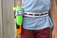 Super-simple holster for toy weapons or tools of choice.  Uses velcro to stick things to the belt...interesting thought.