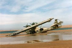 On the west coast of Africa lays a crashed sea-plane that looks like its been there for decades.