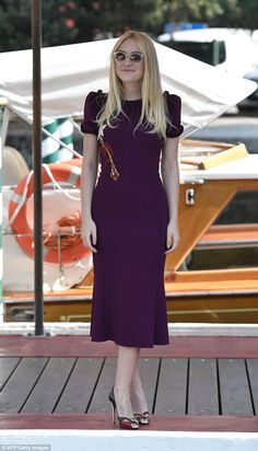 Second look: The actress later emerged in a striking purple gown with glittering embellishment on the bodice