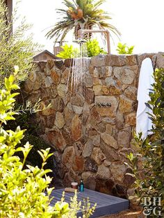 large stone wall outdoor shower