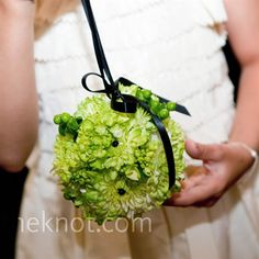 For your flower girl..a pomander filled with green blooms like mums, bells of Ireland, hydrangeas and hypericum berries.