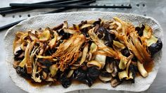Chinese cooks have always loved the intensity of flavour of dried shiitake mushrooms, but I like highlighting the fantastic range of cultivated exotic Asian mushrooms. Mushrooms are an excellent vehicle for flavour and work really well when cooked Chinese-style. This stir-fry celebrates the individual textures and colours of five varieties; the delicacy of oyster and enoki, the slightly meaty, robust flavour of fresh shiitakes and swiss browns and the crunch of cloud ear.