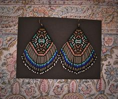Rising Mountain..Beaded Fringe Earrings Native American Inspired by hoofandarrow on Etsy https://www.etsy.com/listing/229489388/rising-mountainbeaded-fringe-earrings