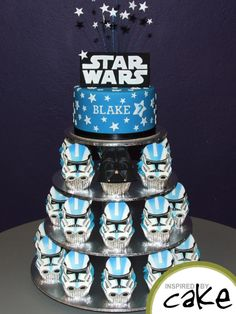 I loved making this star covered Star Wars inspired cutting cake with Storm Trooper cupcakes. Cupcake toppers have all been hand made and coloured. Birthday boy loved Darth Vader so there is only one :) Thanks for looking x