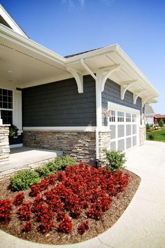 Ironstone siding pairs well with Heather and Sand colored stone.  The Redwood flowers give your house that extra curb appeal.