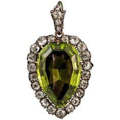 Victorian Peridot Diamond Silver Gold Pendant. Rare Victorian fine colour peridot and diamond pendant on original bale. Set in Silver and 15ct Gold. c 1850