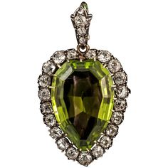 Victorian Peridot Diamond Silver Gold Pendant. Rare Victorian fine colour peridot and diamond pendant on original bale. Set in Silver and 15ct Gold. c 1850