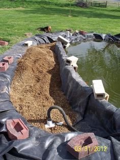 I have two wells, so used them to flush and clean the gravel, which worked really well, since I could drain the water out of the bog, and not into the pond.