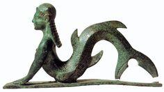 Statuetta in bronzo etrusco che  rappresenta una creatura marina, probabilmente Scilla. VII secolo a.C. Antiquarium di Corciano (PG) da Necropoli di Strozzacapponi (PG)
