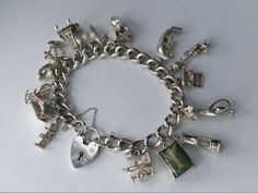 Charm Bracelet Complete with 14 Charms . Vintage, Sterling Silver. Hallmarked 1977 by LittleVintageCharmCo on Etsy