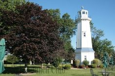 The trademark lighthouse of the Buffalo Launch Club can provide a beautiful outdoor setting for your event! Outdoor Settings, Lighthouse, Statue Of Liberty, Getting Married, Buffalo, Club, Gallery, Building, Wedding