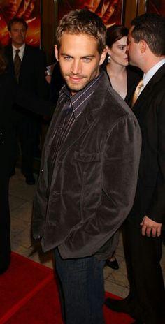 Wearing a corduroy blazer.