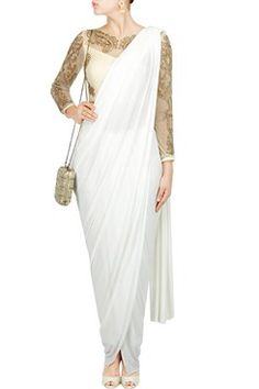 Featuring a white three piece saree set with beaded blouse, silk cigarrete pants and jersey pre-stitched saree drape by BHAAVYA BHATNAGAR Shop now-www.carmaonlineshop.com  #carma #carmaonlineshop #style #fashion #designer #indianfashion #indiandesigner #B