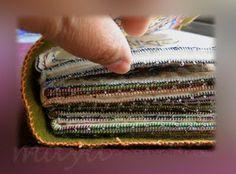 tutorial: make a fiber book  http://millionlittlestitches.blogspot.com/2009/11/how-i-make-my-fiber-books.html