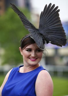 A racegoer arrives for Ladies' Day at the Royal Ascot horse racing festival at Ascot. (Darren Staples/Reuters photo)