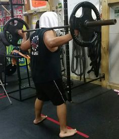 Enhance Fitness studio 12/23/15 strength and conditioning training. Weighted squats with Giovanni!  #weightedsquats #squats #pushyourself #determination #lagrangeillinois