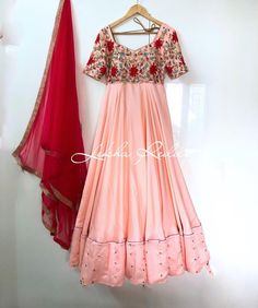 Add some Summer bling to your wardrobe with this gorgeous pastel peach dress with the touch of red beaded embroidery..!!!   Beautiful blush pink color floor length dress with red color dupatta. Dress with floral design hand embroidery thread work on yoke.  25 July 2018