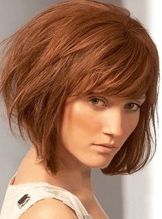 Inverted bob with bangs- love this! I like how it's stacked in the back and you could still sweep the bangs to the side. Very versatile! Probably my next cut!