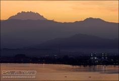 The sunrises behind the mountain and the mountain appears towering over Likas Bay :) Mount Kinabalu, Sea Level, Borneo, Sunrises, Natural World, Exotic, Tower, Mountain, Tropical