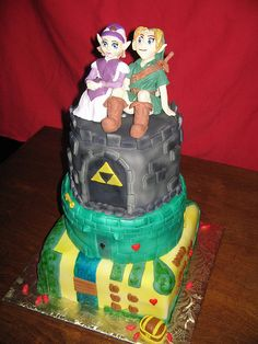 we should totally have a Zelda Wedding Cake..hahaha Part of the grooms cake for us!