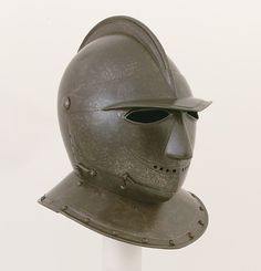 """Closed Burgonet of """"Savoyard"""" Type    Date:ca. 1600–1620  Culture:Italian  Medium:Steel, leather  Dimensions:H. 13 1/2 in. (34.3 cm); W. 10 5/8 in. (27 cm); D. 12 1/2 in. (31.8 cm); Wt. 10 lb. 1 oz. (4562 g)  Classification:Helmets  Credit Line:Gift of William H. Riggs, 1913  Accession Number:14.25.512"""