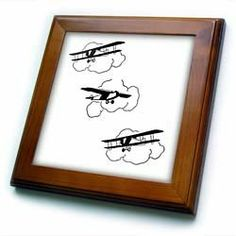 "3 Vintage Cartoon Biplanes - 8x8 Framed Tile by Florene. $22.99. Cherry Finish. Keyhole in the back of frame allows for easy hanging.. Inset high gloss 6"" x 6"" ceramic tile.. Dimensions: 8"" H x 8"" W x 1/2"" D. Solid wood frame. 3 Vintage Cartoon Biplanes Framed Tile is 8"" x 8"" with a 6"" x 6"" high gloss inset ceramic tile, surrounded by a solid wood frame with predrilled keyhole for easy wall mounting."