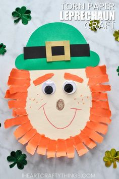 This cute Leprechaun craft for kids is a perfect St. Patrick's Day craft kids of all ages will enjoy. The torn paper construction paper beard adds some festive flair and dimension to this cute kids Leprechaun craft.