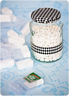 Here's where all the tic-tacs go, so you can use the empty containers for your ribbons...