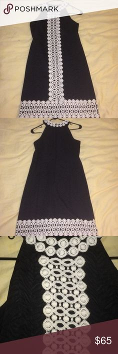 Black mini dress Beautiful black mini dress with white doily lacy embellishment! It's very thick material and the black has a kind of zebra pattern on it. MICHAEL Michael Kors Dresses Mini