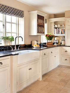 Black granite kitchen worktop shows how to use corner Black Kitchens, Home Kitchens, Kitchen Black, Black Granite Kitchen, Black Granite White Cabinets, White Cupboards, Dark Cabinets, Dream Kitchens, Kitchen Ideas With Black Worktop