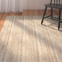 Give your floor space a splash of organic appeal with this stylish - yet versatile - area rug. Hand woven of 100% jute, it features breezy striping in hues of sand, tan and ivory. Set it down in the mudroom along with a weathered wood storage bench and a few iron wall hooks to instantly build a chic entryway ensemble. Play up this piece's versatility by matching it with a reclaimed wood console table, perfect for staging an arrangement of weathered owl figurines for whimsical appeal. Dot…