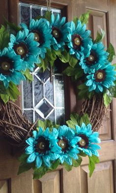 Check out this item in my Etsy shop https://www.etsy.com/listing/240653811/a-turquoise-sunflower-grapevine-wreath
