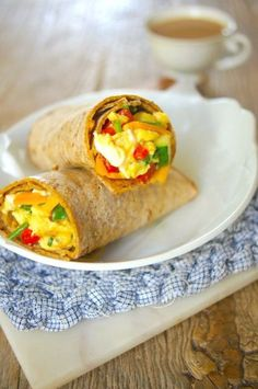 Freezer-Friendly Breakfast Wraps. Made with eggs, veggies, and cheese, they are healthy, easy, filling, portable, and you can freeze and reheat. Recipe on Mom's Kitchen Handbook. #spon
