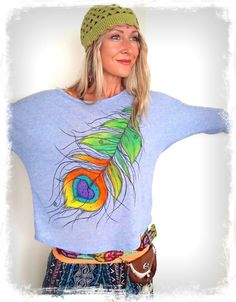 GPyoga real HAND PAINTED Peacock Feather tops are back! Yay ;-)  Only ONE piece available for a size SMALL. Im modeling, being a size XS/S.  Each painted Feather has slight differences. Yours will be painted upon your purchase. Allow about 7-9 business days to prepare your order.  Featuring: * A fabulous light, flowy and breathable material 30% LINEN and 70% polyester (long lasting, nearly lint free) The fabric is semi-transparent-great for layering! I have a light gray tank top as a und...