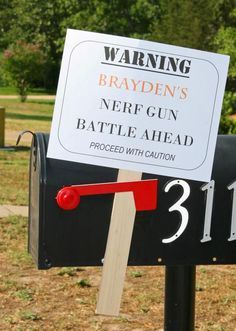 Nerf gun birthday party warning sign & then SHOOT them as they come in! Haha