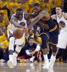 Golden State Warriors' Draymond Green and Cleveland Cavaliers' Tristan Thompson vie for a loose ball in overtime of Warriors' 108-100 win in Game 1 of the 2015 NBA Finals at Oracle Arena in Oakland, Calif., on Thursday, June 4, 2015. Photo: Scott Strazzante, The Chronicle