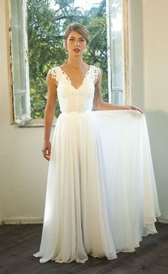 Romantic vintage inspired wedding gown, I could see this working. I like the flow