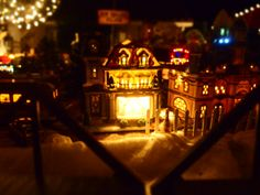 Christmas spirit at Jackie's house. Huntington Beach, CA. The most beautiful display I have ever seen - hundreds of these music box houses displayed as a magical Christmas town. She has a   gorgeous Nativity in the driveway, a music box circus and everything else you can imagine!