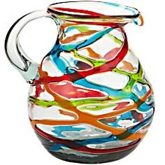 Colorful Ribbons Pitcher - It's been fired at 2300 degrees Fahrenheit, then mouth-blown—a centuries-old technique—and cooled into a bold, beautiful, truly individual shape.