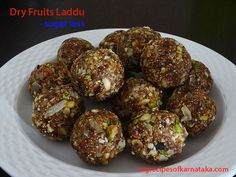 Dry fruits laddu or dry fruits ladoo recipe explained with step by step pictures. Dry fruits laddu is prepared using cashew, badam, pista, dates and raisins. This is a sugar free dry fruits laddu recipe. In this dry fruits laddu or ladoo fig and walnut are optional ingredients. This is a very easy dry fruits laddu recipe.
