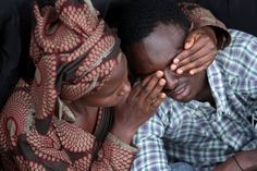 Pin for Later: Powerful Images Out of Rwanda on the 20th Anniversary of the Genocide  Twenty-two-year-old Bizimana Emmanuel was consoled by a female friend as they commemorated the lives lost at today's ceremony in Kigali.