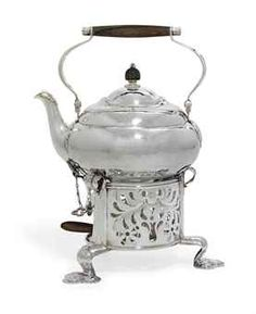 A GEORG JENSEN SILVER AND ROSEWOOD KETTLE, STAND AND BURNER DESIGNED BY GEORG JENSEN  1919-1927